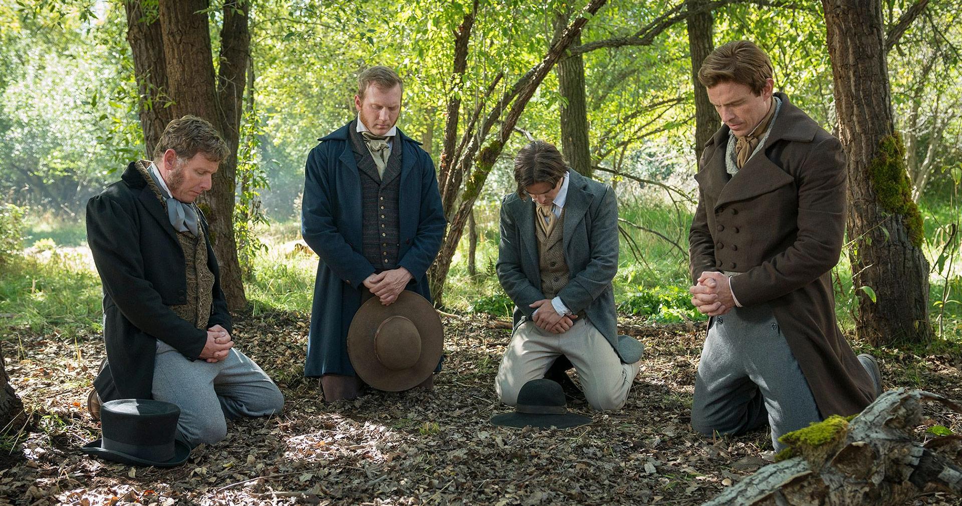 Joseph prays with the Three Witnesses. Image via Church of Jesus Christ.