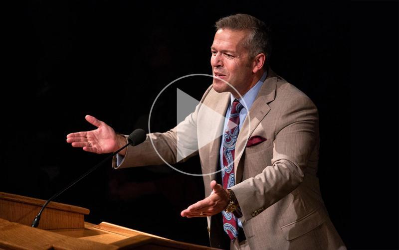 Image of Eric D. Huntsman presenting. Photo by Madeline Mortensen, BYU via KUER.