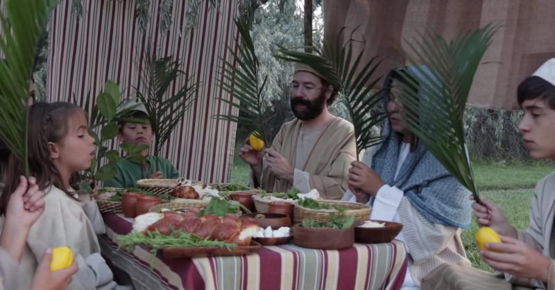 Israelite family in their booth during Sukkot.