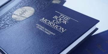 The Book of Mormon with other books.